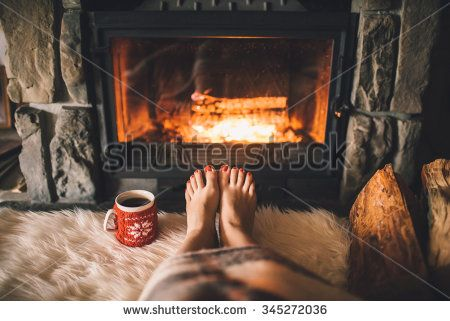 Royalty-free Bare woman feet by the cozy fireplace.… #345271847 ...