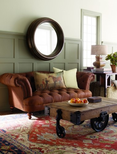 large round mirror, the sofa, coffee table cart & the equestrian themed pillow ~ also like the batten design on the wall