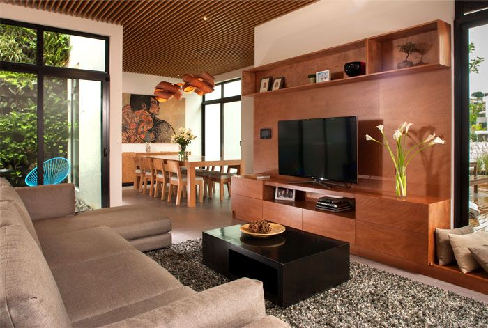 Mexican House in Neutral Color Palette with Lots of Warm Wood - InteriorZine