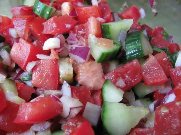 Healthy Cucumber/Tomato Salad  just might have to whip up a small batch tonight, only use fresh garlic instead of garlic salt :) & cherry tomatoes :)