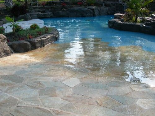 shallow beach-like area in the pool for staying cool while tanning!