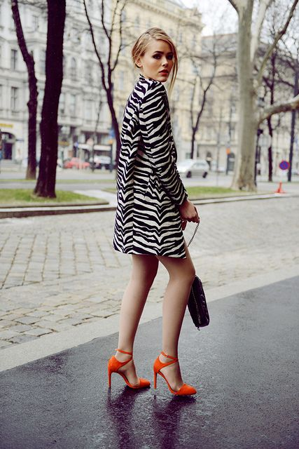 Okay...maybe it's not me but I love this.  zebra print coat + orange pumps.