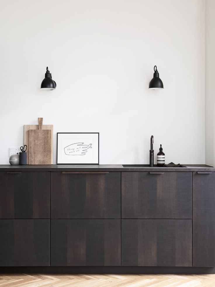Reform's IKEA kitchen by Norm Architects. A design in sawn smoked oak with handles in tombac. It's an IKEA hack.