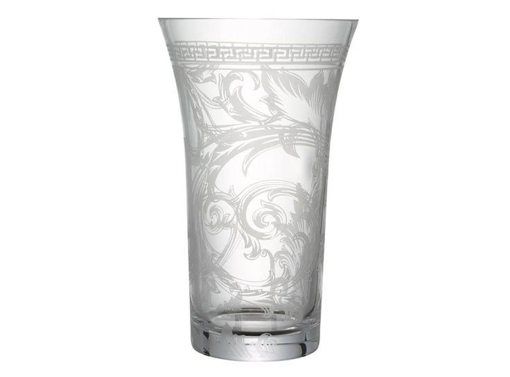 Versace's telltale Greek fret design adorns the rim of this fluted crystal vase etched with a stunning flourish design. An ideal size for longer, elegant stems, the design's combination of plain and frosted glass will offer an interesting foreground for your blooms. #LuxDeco #Design #Homeware