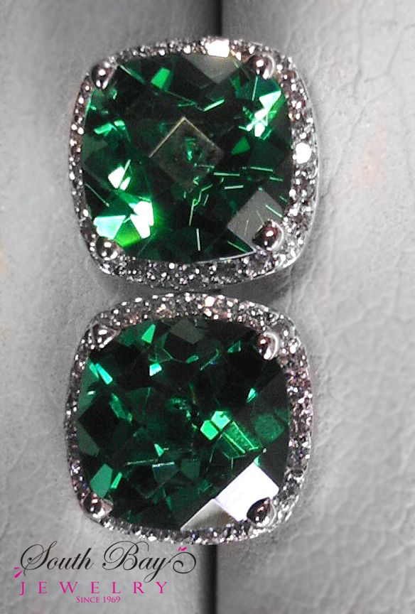 6 carats of cushion emeralds and 1.25 carats of G-H SI round brilliant diamonds
