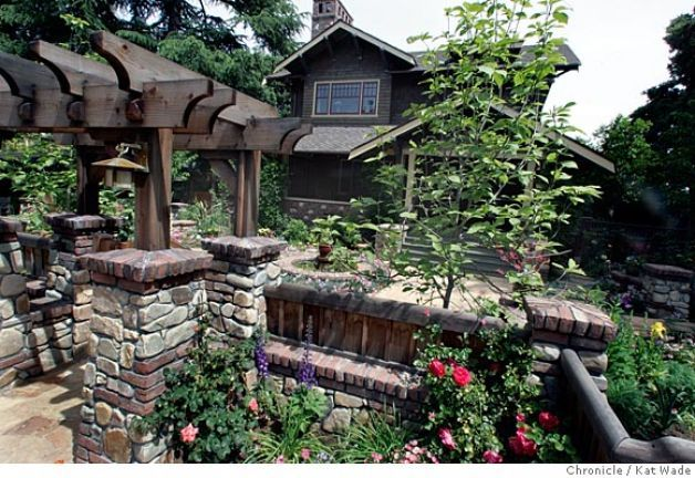 On 4/26/05 in Los Altos Debbie Segers recently designed garden including the front gate and rock walls pictured here was designed to complement the craftsmen-style architecture of the bungalow home..   Kat Wade/ The Chronicle Photo: Kat Wade / SF