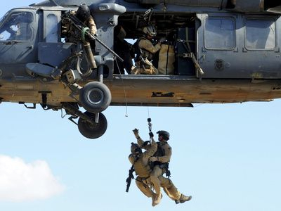 Pararescuemen Are Hoisted Into An HH-60 Pavehawk Helicopter