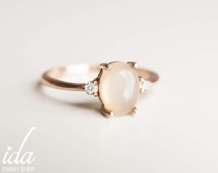 Moonstone Engagement Ring - Rose Gold Engagement Ring - Diamond Engagement Ring - Rings - Cluster Ring - Engagement Rings for Women by IdaJewelryDesign on Etsy https://www.etsy.com/listing/521340535/moonstone-engagement-ring-rose-gold