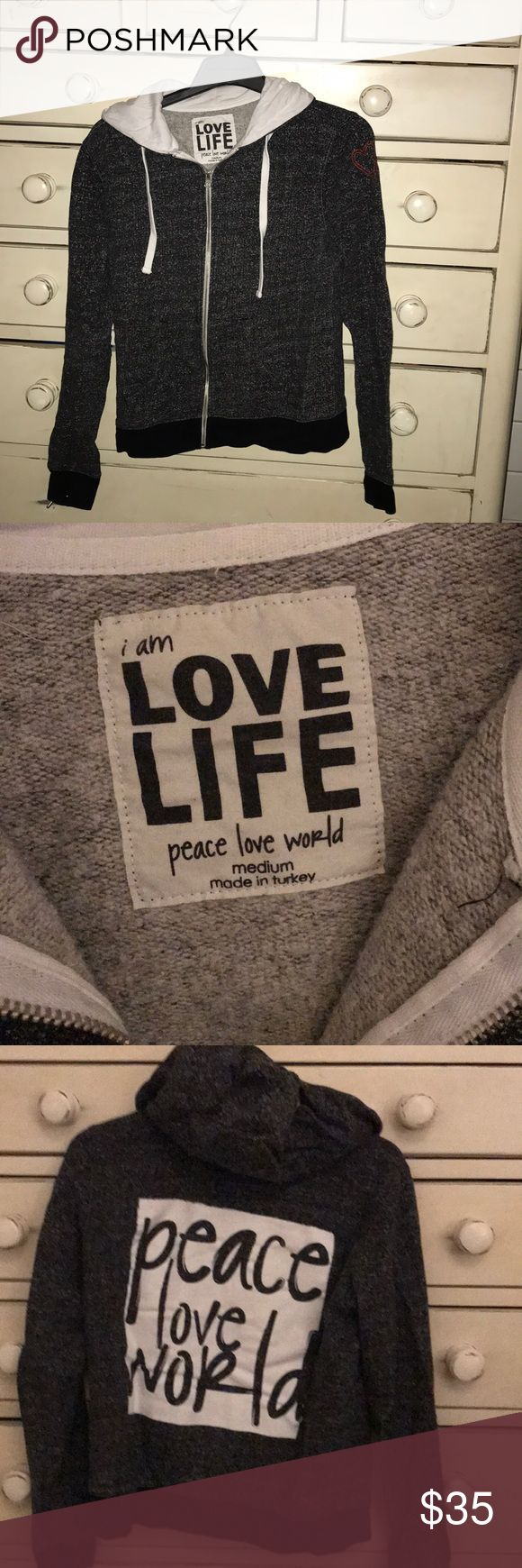 Peace Love World hoodie Style up and look great heading to the gym or just to spend the day relaxing around town or home.  Zip up with thumb holes on the sleeves to be extra special. Make a peace love world statement! Peace Love World Tops Sweatshirts & Hoodies