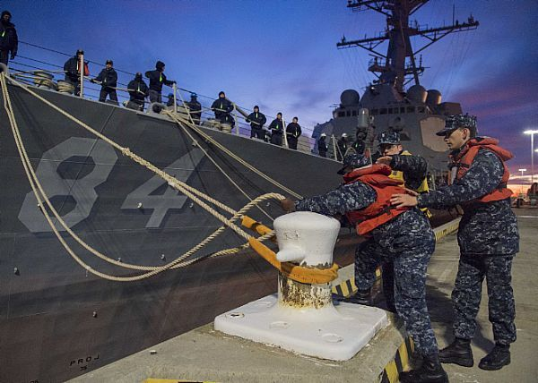 180131-N-SG189-0080  NORFOLK (Jan 31, 2018) Sailors remove mooring lines as the guided-missile destroyer USS Bulkeley (DDG 84) prepares to depart Naval Station Norfolk. Bulkeley is underway for a composite training unit exercise (COMPTUEX), which evaluates the strike group's ability as a whole to carry out sustained combat operations from the sea, ultimately certifying the Harry S. Truman Carrier Strike Group for deployment. (U.S. Navy photo by Mass Communication Specialist Seaman Keith…
