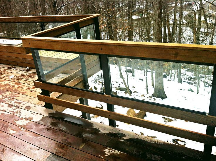 Glass inserted into wooden railings on balcony.
