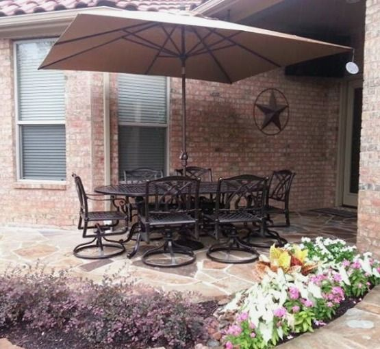 Treasure Gardenu0027s X Umbrella Shading A X Grand Terrace Oval Dining Table  And Swivel Dining Chairs By Gensun Casual Yard Of The Month   July   Yard  Art Patio ...