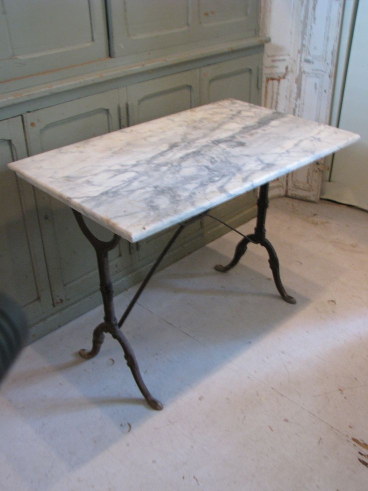 Nice early bistro table from France. Iron base Table measures 24 x 39.5 28.5 high White marble with grey veining. There is a small chip on the