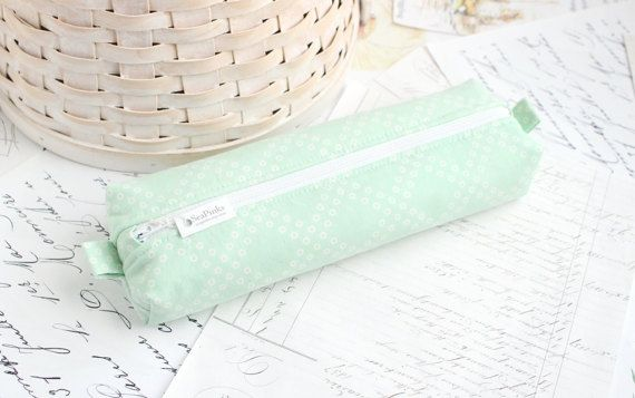 This a cute, soft boxy pencil case made of a cool mint green and white cotton print. Great for collecting all your pencils, pens or anything else you can fit in there. Its measurements are approximately 10in x 3in x 1in (25cm x 8cm x 3cm) and has a little tab on either end for zipper pulling or for a keyring. ♥ Lined with stabilizer and another layer of fabric. ♥ See more in my pencil case section https://www.etsy.com/shop/SeaPinks?section_id=13923161 ♥ See more from ...