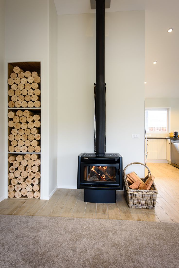 A modern home with a classic country feel. Wood and stone features are found throughout this show home, while these fire-side wood boxes are both functional and stylish!