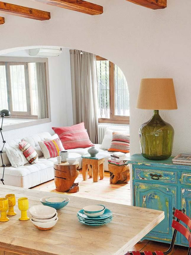 Bright pops of color, mediterranean style and exposed beams
