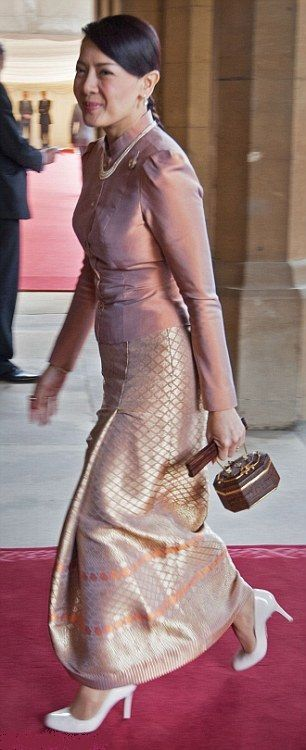 Princess Srirasm of Thailand wore a pretty blush pink silk top with metallic skirt during the monarch's Diamond Jubilee event in May 2012 at Buckingham Palace.