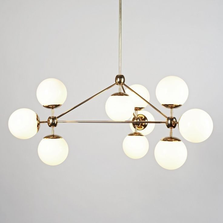 The modo chandelier with white opal glass gives a soft light that creates a relaxing and dynamic atmosphere in any room