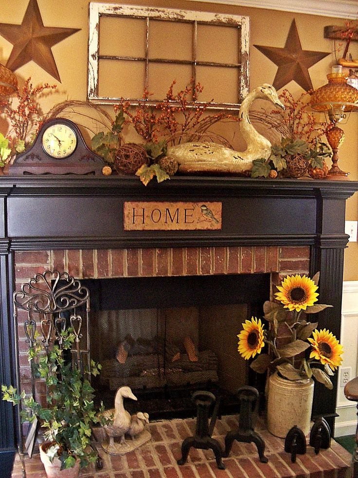 Primitive Style... like the Home sign and sunflowers in a container on the hearth