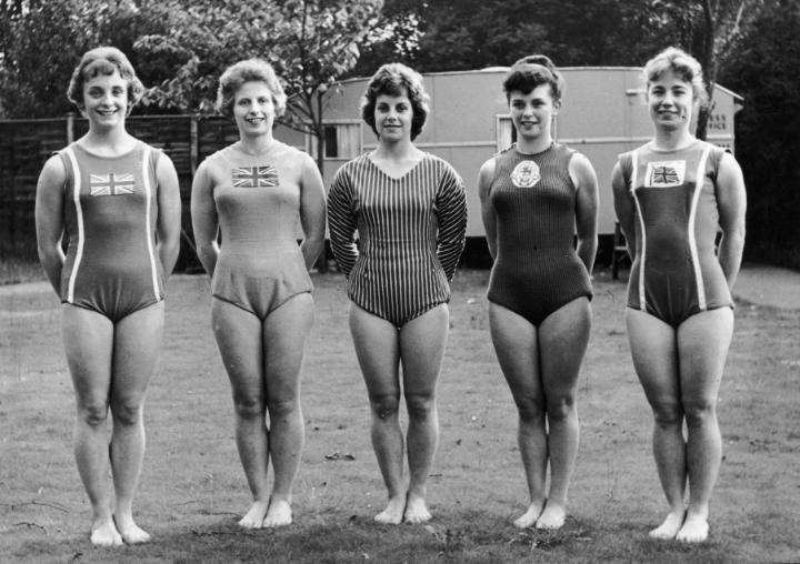 British Gymnasts (June 1960): Full-length portrait of the British Olympic women's gymnastic team, (L-R) Denise Godard, Pat Perks, Gwynedd Lingard, Dorothy Summers and Margaret Neale, wearing team leotards while standing on a lawn. Fifteen-year-old Godard was unable to compete at the games in Rome due to the cutoff age of 18. (Photo by Express/Express/Getty Images)