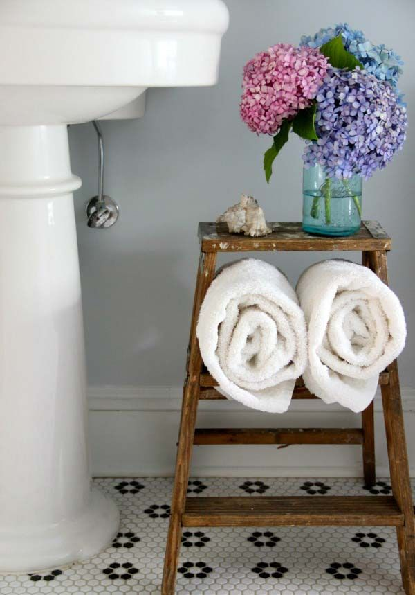 Sure, it's cute, but this vintage find also doubles as a towel holder and resting place for flowers or magazines. See more at Eclectically Vintage »  - GoodHousekeeping.com