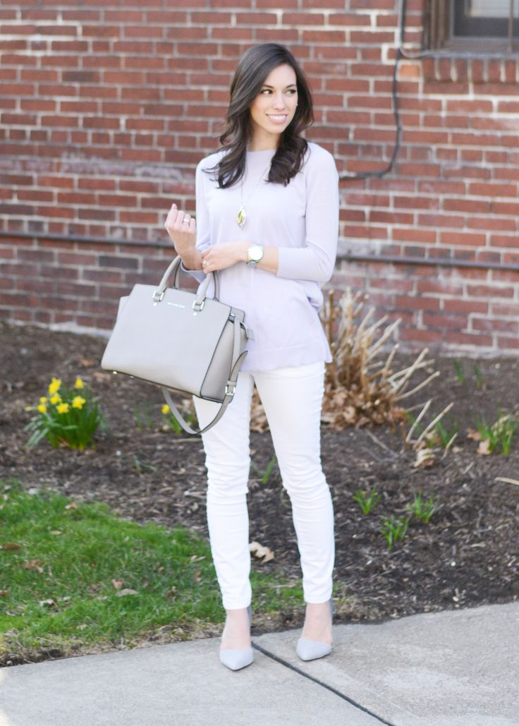 Try a tunic sweater and white skinny jeans with the Michael Kors Selma bag and D'orsay pumps for a chic and classic outfit. Click for more outfit inspiration!