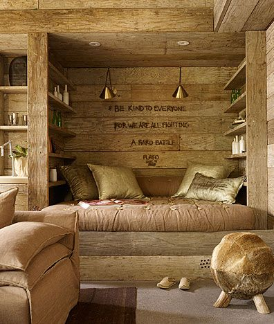 like the metallic pillows with copper pendants above. Would be really pretty for a log cabin bedroom. Copper tones.