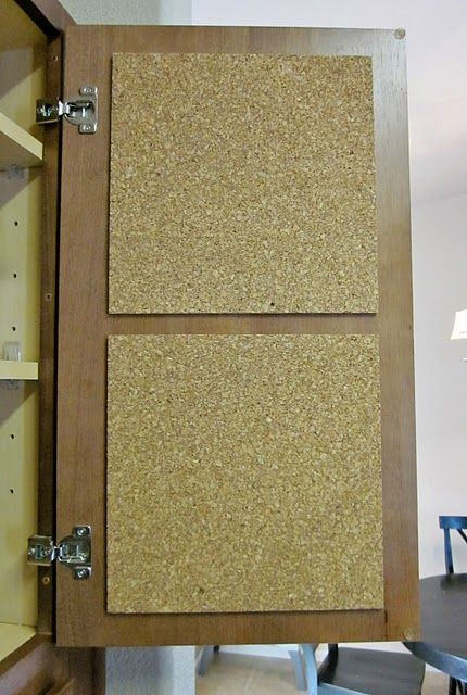 Adhesive cork squares inside kitchen cabinet doors, for recipes, grocery lists, etc.