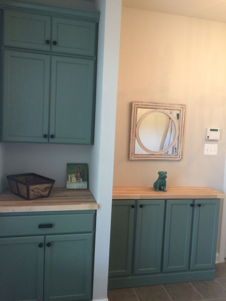 Sherwin williams dried thyme painted on Home Depot unfinished oak cabinets in mudroom