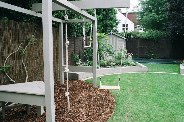Children's play frame with swing, knotted rope, trapese and platform
