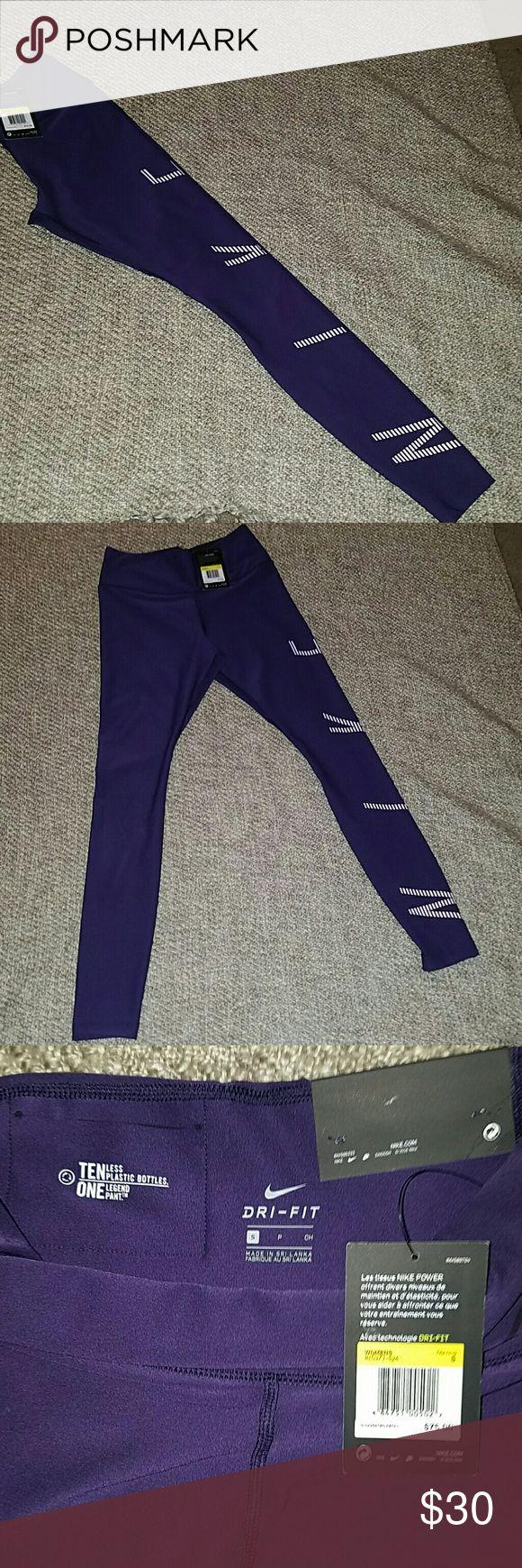 NWT Nike leggings. Dark purple Nike leggings with Nike name in white down left leg. Nike Pants Leggings
