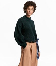Knit sweater in a soft mohair blend with low dropped shoulders and long balloon sleeves. Ribbed cuffs and wide ribbing at neckline.