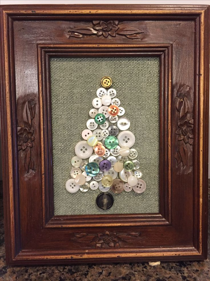 Up cycled  vintage buttons made into a Christmas tree and frame.  A sage green chenille fabric was used for the background.