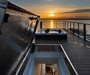 hatch access rooftop deck with a HOT TUB. Watching the sunset in