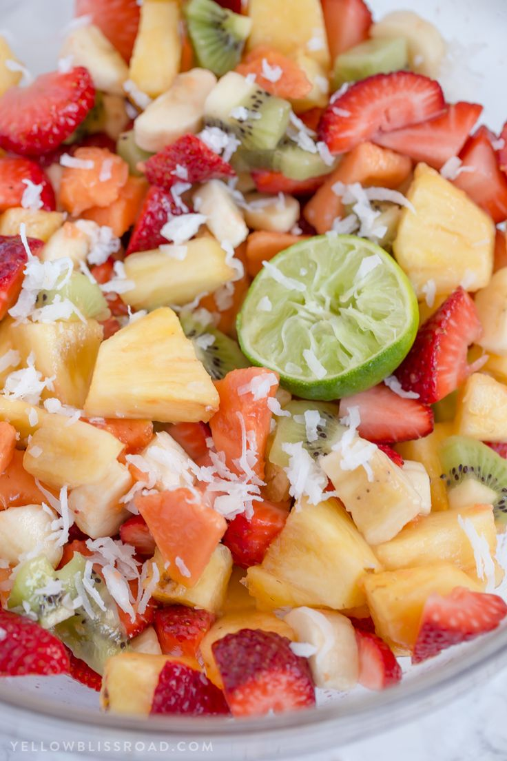 This Tropical Fruit Salad with Honey Lime Dressing is the light and refreshing and the perfect snack or side dish to any spring or summer mea via @yellowblissroad