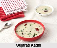 Gujarati Kadhi is a yogurt based sweet and spicy curry that is simple. The Kadhi goes well with any vegetable. For the recipe visit the page. #recipes #food #vegetarian