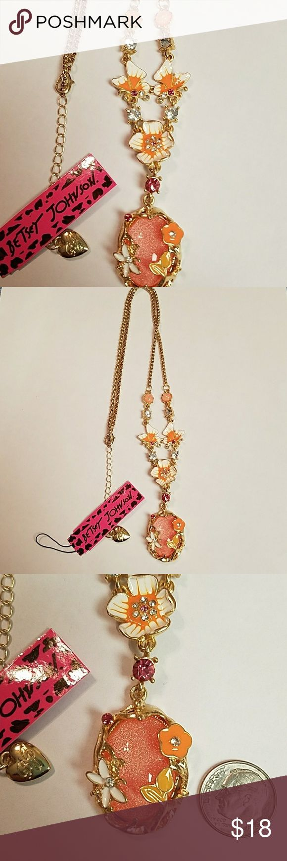 Gorgeous orange and white statement necklace This necklace is absolutely gorgeous with a pearlized orange tone with white and cream clear crystals butterflies flowers absolutely gorgeous wonderful for fall season 22 in Long Betsey Johnson Jewelry Necklaces