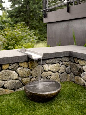 Stone dog water bowl with stainless steel water rill. Pinned to Garden Design - Water Features by Darin Bradbury.
