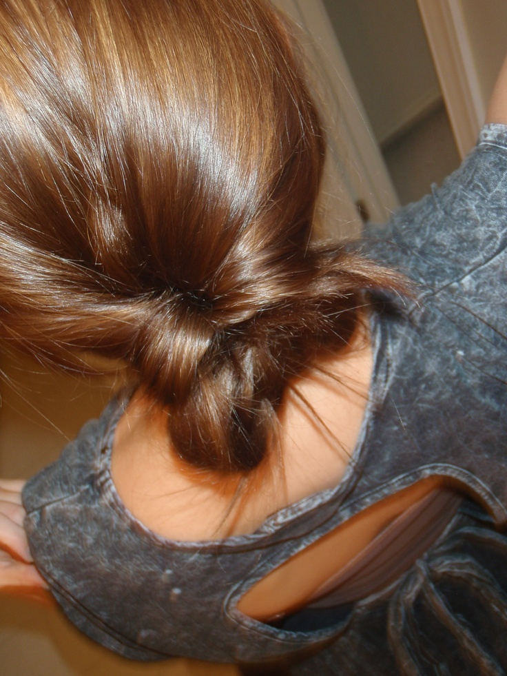 My favorite and the easiest hair style ever. Put your hair into a low pony, split the pony into a v and pull the pony tail through, then put the bottom half of the pony tail into a bun.