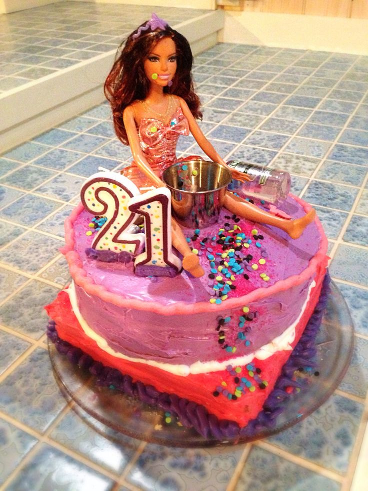 Probably my favorite cake, really funny for a 21st birthday, the biggest challenge was finding a brown haired Barbie to look like me. We colored her hair with a sharpie