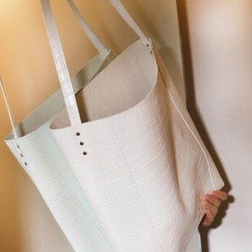 [White Cutting Bag] A faux leather crossbody bag featuring a cutted details. Adjustable shoulder straps, but not too short. Very Special and Unique design.