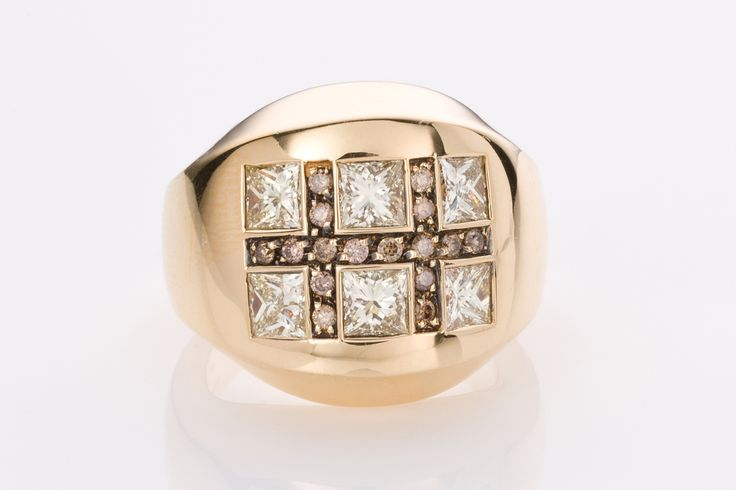 """A Luca Carati dress ring from the """"Poh Kong"""" collection is 18ct yellow gold featuring six bright and lively princess cut diamonds set in a square pattern, with angular lines of cognac coloured diamonds intersecting the princess cuts. The modern brilliant princess cut diamonds weigh a total of approximately 2.27cts, light yellow, C5. This ring is a very weighty piece of 19.90grams. Designed by the Italian jewellery house of Luca Carati, it is superbly handcrafted and is beautiful piece to…"""