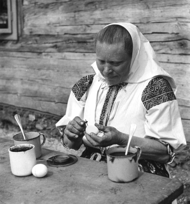 Happy Easter. Spring is on it's way. Is it? Woman painting easter eggs.  Žena pri maľbe kraslíc. Fačkov (okr. Žilina), 1955. Archív pozitívov Ústavu etnológie SAV. Foto I. Grossmann