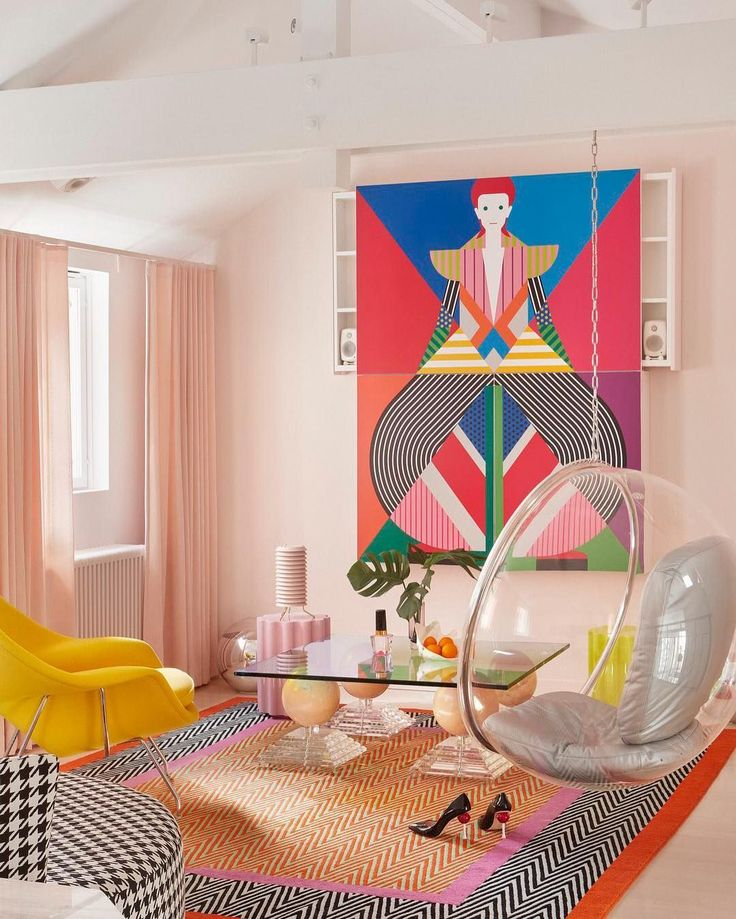 """[repost] Tag someone who would appreciate a space like this, where creativity meets relaxation. . Shoe designer @minnaparikkashoes loves """"creating worlds that are filled with fantasy and escape from the mundane,"""" and her home is no exception.   Photo: @katrikapanen (@elledecor) . #interiordesign #art #class pastels #bright #yellow #orange #white #pink #livingroom #decor #interiorstyling #interiordesignideas #livingroom #houndstooth #chevron #drapes #heels #shoes"""