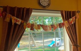 Use an apple as a stamp to make this banner - perfect fall activity for young kids
