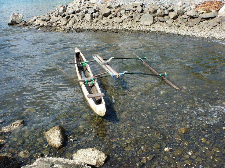 Lonely boat at Tablanusu beach, Papua, Indonesia