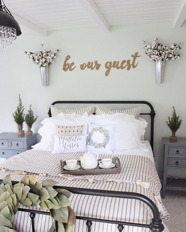 "Ready for family to arrive for Christmas! Let's be honest though, I haven't wrapped any presents  yet!  I know what I'll be spending my morning doing! Special thanks to @cbtdesigns for my ""be our guest"" wood calligraphy words! I got the inspiration from my sister in law @linzahcross ! Pillows from @sovintagechic . Bedspread from #ballarddesigns #beourguest #12daysofdecor #christmascheerisfinallyhere #thepolishedfarmhouse #jojomademedoit #mybhg #wednesdaywalldecor #mysouthernliving #welcoming"