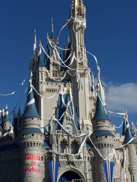 """On Nov. 16, 2004, Cinderella Castle was modified to appear as though it was strewn with toilet paper, and """"Stitch is King"""" was posted on a turret as faux graffiti to mark the grand opening of Stitch's Great Escape! that day."""