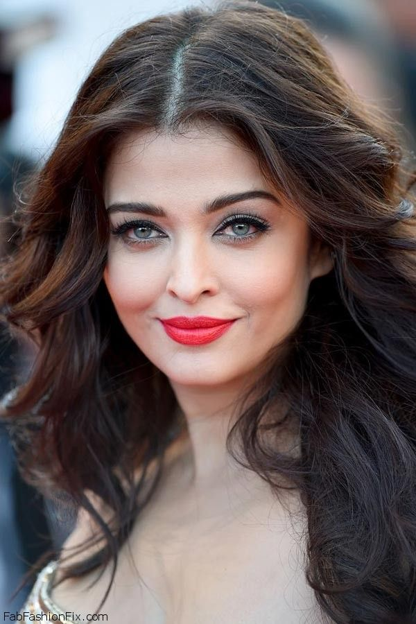 "Gorgeous Aishwarya Rai with bold red lips makeup look at the ""Deux Jours, Une Nuit"" Premiere during the 67th Annual Cannes Film Festival."