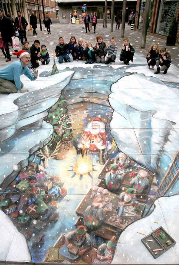 "Veteran 3D street painter, Julian Beever made a surprise late appearance in December of this year with his ""Santas Grotto"" picture in Camberley, UK. Beever is one of the most famous and well known 3D street art painters and he took 4 days to create this piece in chalk.:"